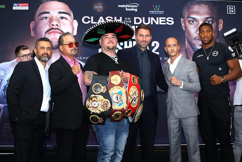 LONDON, ENGLAND - SEPTEMBER 06: Manny Robles, Andy Ruiz Sr, Andy Ruiz Jr, Eddie Hearn, Anthony Joshua  and Omar Khalil during the press conference for Andy Ruiz Jr. v Anthony Joshua 2 'Clash on the Dunes' at the Hilton Syon Park on September 06, 2019 in London, England. Anthony Joshua and Andy Ruiz Jr will have a Heavyweight World Title rematch fight on December 7th 2019 in the historical town of Diriyah, Kingdom of Saudi Arabia. (Photo by Richard Heathcote/Getty Images)
