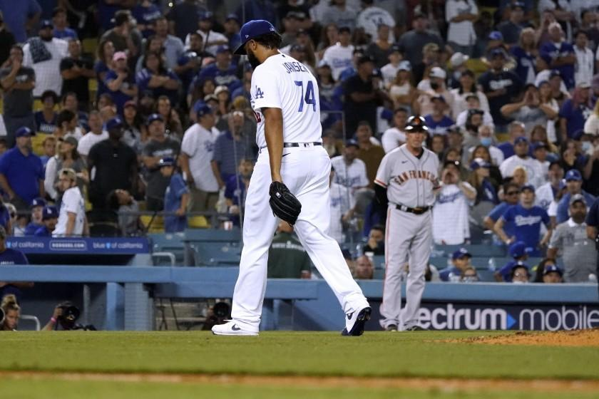 Dodgers pitcher Kenley Jansen walks off the field after being pulled in the ninth inning Thursday.