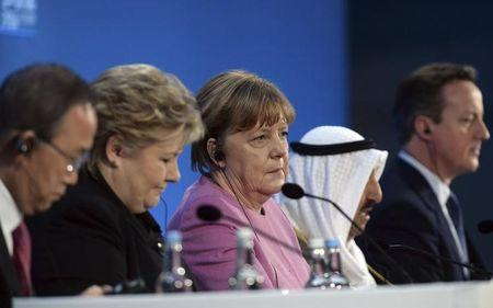 German Chancellor Angela Merkel (C) listens to speakers at the donors Conference for Syria in London, Britain February 4, 2016. REUTERS/Stefan Rousseau/pool