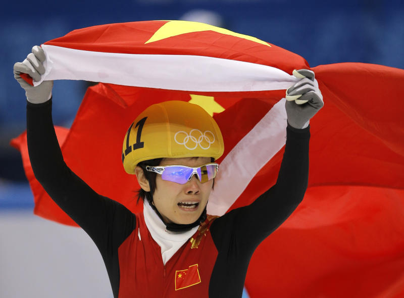 Li Jianrou of China celebrates winning the women's 500m short track speedskating final at the Iceberg Skating Palace during the 2014 Winter Olympics, Thursday, Feb. 13, 2014, in Sochi, Russia. (AP Photo/Vadim Ghirda)