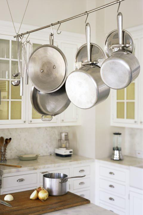 "<p>When it comes to your pots and pans, Garten prefers <a href=""https://www.amazon.com/All-Clad/b/ref=w_bl_hsx_s_ki_web_2581965011?ie=UTF8&node=2581965011&field-lbr_brands_browse-bin=All-Clad&tag=syn-yahoo-20&ascsubtag=%5Bartid%7C10063.g.35213045%5Bsrc%7Cyahoo-us"" rel=""nofollow noopener"" target=""_blank"" data-ylk=""slk:All-Clad"" class=""link rapid-noclick-resp"">All-Clad</a> and says every size isn't a must-have, but all of these are: ""Small and large sauté pans, small and large lidded pots and a large stockpot.""</p>"