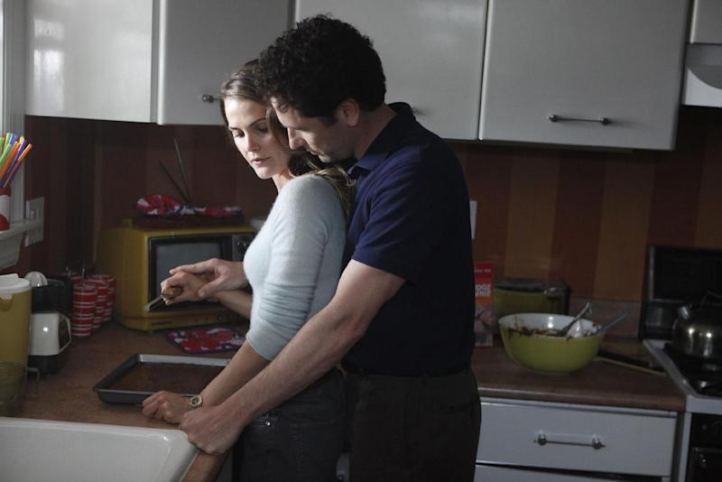 """This undated publicity photo released by FX shows Keri Russell as Elizabeth Jennings, left, and Matthew Rhys as Phillip Jennings in a scene from """"The Americans."""" The new FX drama, airing Wednesday at 10 p.m. EST on FX, focuses on two KGB spies posing as an ordinary American couple shortly after Ronald Reagan was elected president. (AP Photo/FX, Craig Blankenhorn)"""