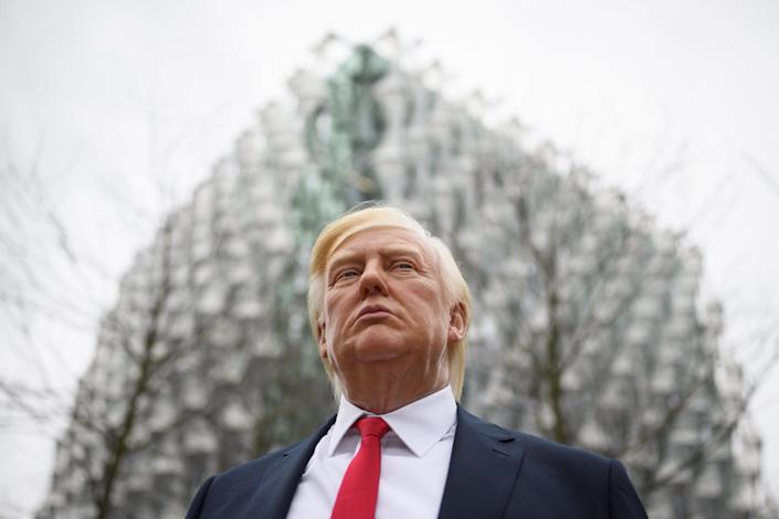 A model of President Donald Trump from Madame Tussauds waxwork attractions standsoutside the new U.S. Embassy in London on Jan. 12, 2018.