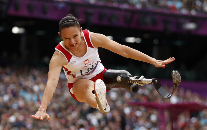 Poland's Ewa Zielinska makes a jump in the women's long jump F-42/44 category during the athletics competition at the 2012 Paralympics, Sunday, Sept. 2, 2012, in London. (AP Photo/Matt Dunham)
