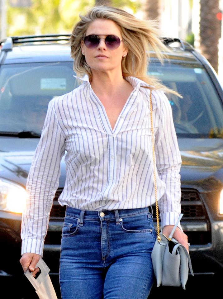 """<p><i>I love Ali's button-up top <a rel=""""nofollow"""" href=""""http://people.com/celebrity/star-tracks-wednesday-march-22-2017/blonde-ambition"""">here</a>! Where is it from? -Alana</i><i></i>You can never have too many of this wardrobe staple! While Ali's <a rel=""""nofollow"""" href=""""https://www.jennikayne.com/collections/tops/products/silk-cotton-striped-boyfriend-shirt-ivory-blue https://click.linksynergy.com/fs-bin/click"""">Jenni Kane silk boyfriend shirt</a> will set you back $410, you can buy a similar version from <a rel=""""nofollow"""" href=""""https://click.linksynergy.com/fs-bin/click?id=93xLBvPhAeE&subid=0&offerid=466652.1&type=10&tmpid=13998&RD_PARM1=https%3A%2F%2Fwww.jcrew.com%2Fp%2Fwomens_category%2Fsuiting%2Fsuitingshirts%2Fstretch-perfect-shirt-in-classic-stripe%2F44175&u1=POFASYAWFKFMAR"""">J.Crew</a> for under $70. <i></i></p>"""