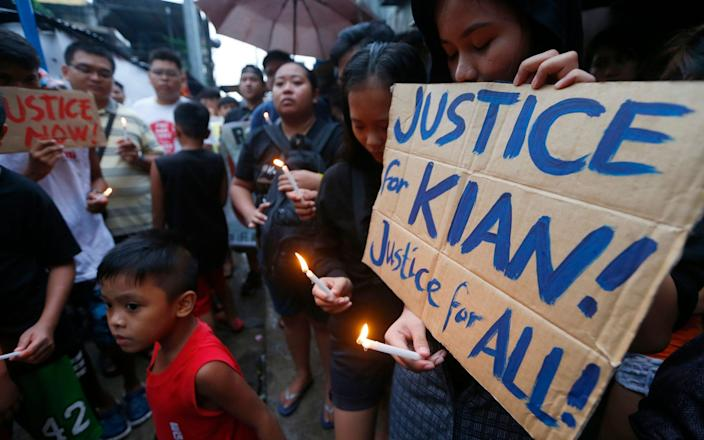 Seventeen-year-old Kian Delos Santos was allegedly shot three times by undercover police officers - AP