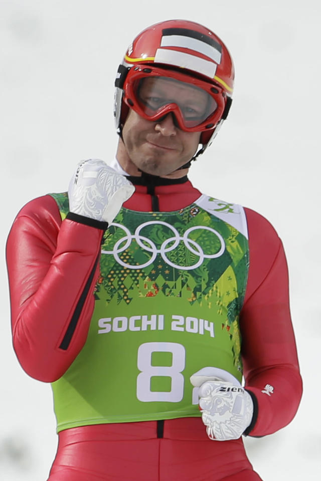 Austria's Christoph Bieler celebrates after his attempt during the ski jumping portion of the Nordic combined Gundersen large hill team competition at the 2014 Winter Olympics, Thursday, Feb. 20, 2014, in Krasnaya Polyana, Russia. (AP Photo/Gregorio Borgia)