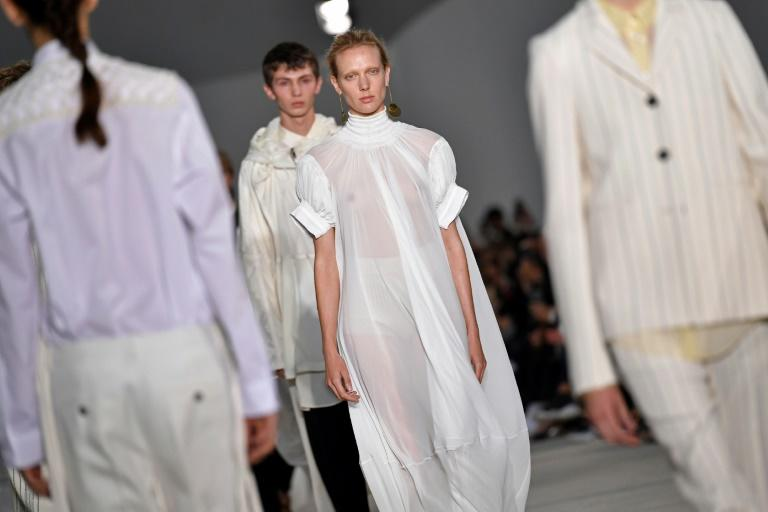 Models present creations for fashion house Jil Sander designed by husband and wife duo Luke and Lucie Meier