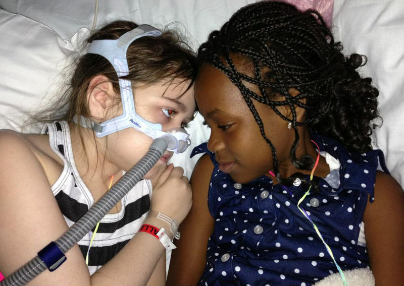 In this May 30, 2013 photo provided by the Murnaghan family, Sarah Murnaghan, left, lies in her hospital bed next to adopted sister Ella on the 100th day of her stay in Children's Hospital of Philadelphia. Hoping to get a lung transplant, the 10-year-old suburban Philadelphia girl has been hospitalized at Children's Hospital of Philadelphia for three months with end-stage cystic fibrosis. (AP Photo/Murnaghan Family)