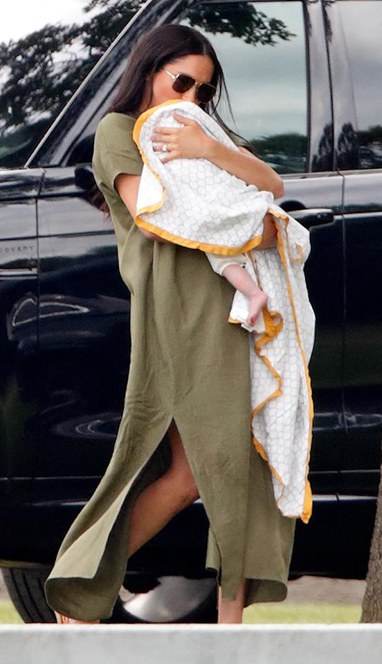 The new mother chose a khaki dress by Lisa Marie Fernandez (approximately £476) for a day at the polo. She completed the look with aviator sunglasses. [Photo: Getty]