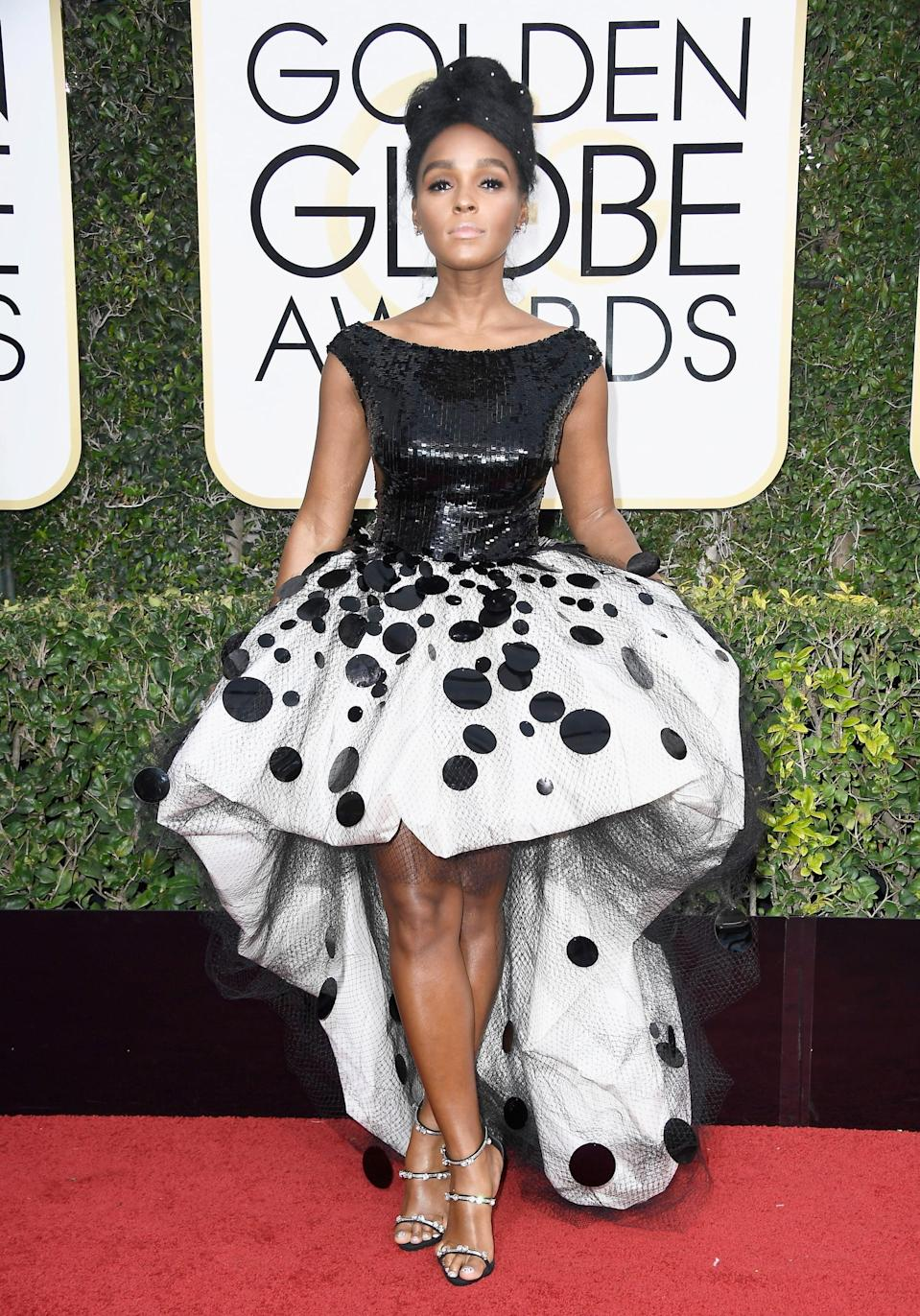 <p>Janelle wore an Armani asymmetrical dress, Giuseppe Zanotti heels, and Forevermark jewels to the 2017 Golden Globe Awards.</p>