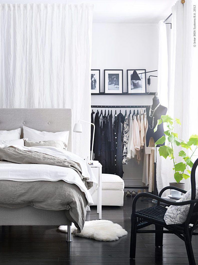 <p>Leave it to IKEA to present the perfect small space hack for closetless rooms: Run a curtain along one wall to separate out a narrow space with a rolling rack and chaise and voilà! </p>