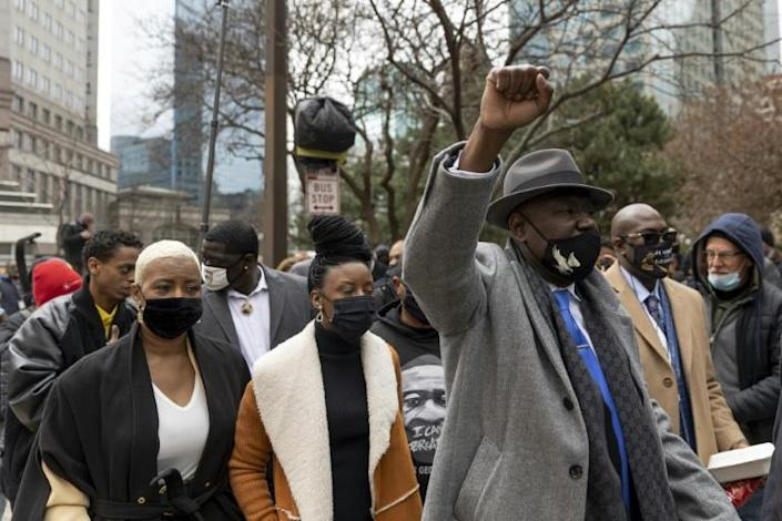 Attorney Ben Crump, (L) and family members of George Floyd arrive ouside the couthouse during the trial of former Minneapolis police officer Derek Chauvin in Minneapolis, Minnesota on April 19, 2021