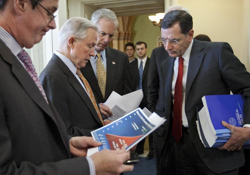 From left, Sen. David Vitter, R-La., Sen. Jeff Sessions, R-Ala., ranking Republican on the Senate Budget Committee, Sen. Ron Johnson, R-Wis., and Sen. John Barrasso, R-Wyo., prepare for a news conference on Capitol Hill Hill in Washington, Monday, Feb. 13,2012, to voice their opposition to President Barack Obama's fiscal 2013 federal budget.  (AP Photo/J. Scott Applewhite)