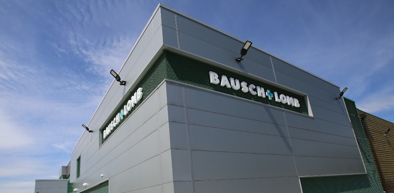 Gray building with green trim and white Bausch & Lomb lettering.