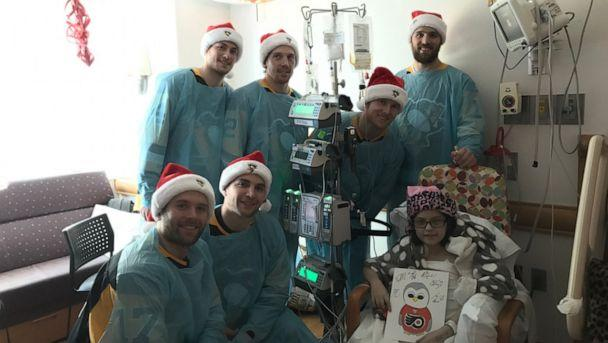 PHOTO: Members of the Pittsburgh Penguins visit Jaycee in the hospital after she got a multivisceral transplant. (The Park Family)