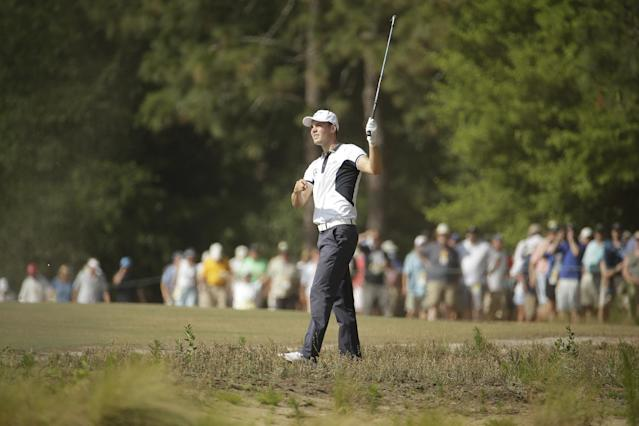 Martin Kaymer, of Germany, hits from the natural area on the seventh hole during the final round of the U.S. Open golf tournament in Pinehurst, N.C., Sunday, June 15, 2014. (AP Photo/Charlie Riedel)