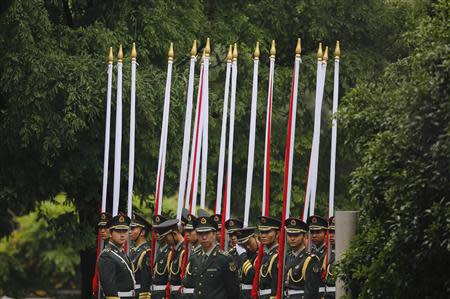 Honour guards wait for the arrival of visiting Russian President Vladimir Putin during a bilateral meeting with Chinese President Xi Jinping at Xijiao State Guesthouse, ahead of the fourth Conference on Interaction and Confidence Building Measures in Asia (CICA) summit, in Shanghai May 20, 2014. REUTERS/Carlos Barria