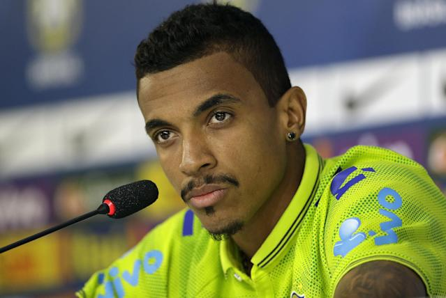 Brazil's Luiz Gustavo looks on during a news conference after a training session in Teresopolis, Brazil, Wednesday, June 25, 2014. Brazil will face Chile on June 28 in the round of 16 of the 2014 soccer World Cup. (AP Photo/Andre Penner)