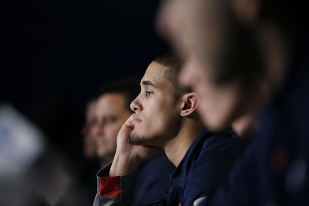 Arizona's Nick Johnson, center, listens to a question during a news conference at the NCAA college basketball tournament on Friday, March 28, 2014, in Anaheim, Calif. Arizona plays Wisconsin in a regional final on Saturday. (AP Photo/Jae C. Hong)