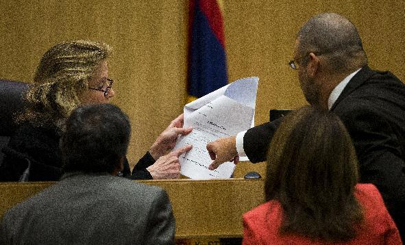 Judge Sherry Stephens and attorneys Juan Martinez, left, Jennifer Willmott and Kirk Nurmi, right, go over questions submitted by jurors at the murder trial of Jodi Arias, Wednesday, March 6, 2013, in Maricopa County Superior Court in downtown Phoenix. Arias is on trial for the murder of Travis Alexander in 2008. (AP Photo/The Arizona Republic, Tom Tingle, Pool )