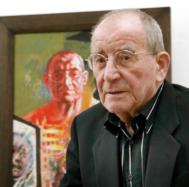 FILE - In this March 10, 2007 file picture German painter Willi Sitte waits in the gallery for contemporary Art in front of his self-portrait 'Me and Kosovo' (1999) in Merseburg, Germany. According to German news agency Dpa, painter Willi Sitte died on Saturday June 8, 2013 in his house in Halle, eastern Germany. He was 92. (AP Photo/dpa,Waltraud Grubitzsch,File