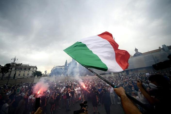"""Protesters in Italy demonstrated against a mandatory """"green pass"""" for indoor dining and entertainment"""