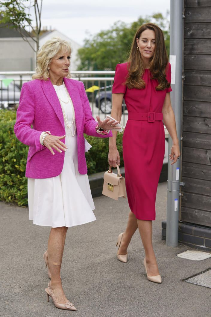 Britain's Kate, Duchess of Cambridge, right, and US First Lady Jill Biden during a visit to Connor Downs Academy in Hayle, West Cornwall, during the G7 summit in England, Friday, June 11, 2021. (Aaron Chown/Pool photo via AP)