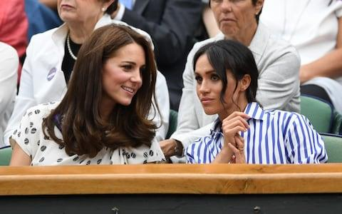 The Duchess of Cambridge and Duchess of Sussex at Wimbledon - Credit: Heathcliff O'Malley