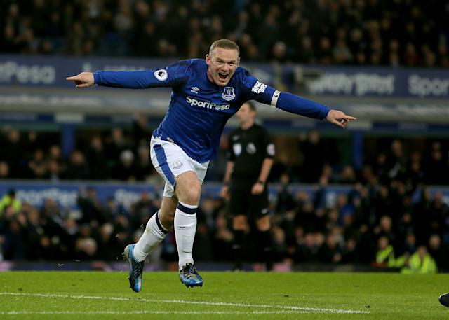 Returning hero: Rooney celebrates scoring during his second spell at Everton. (PA)