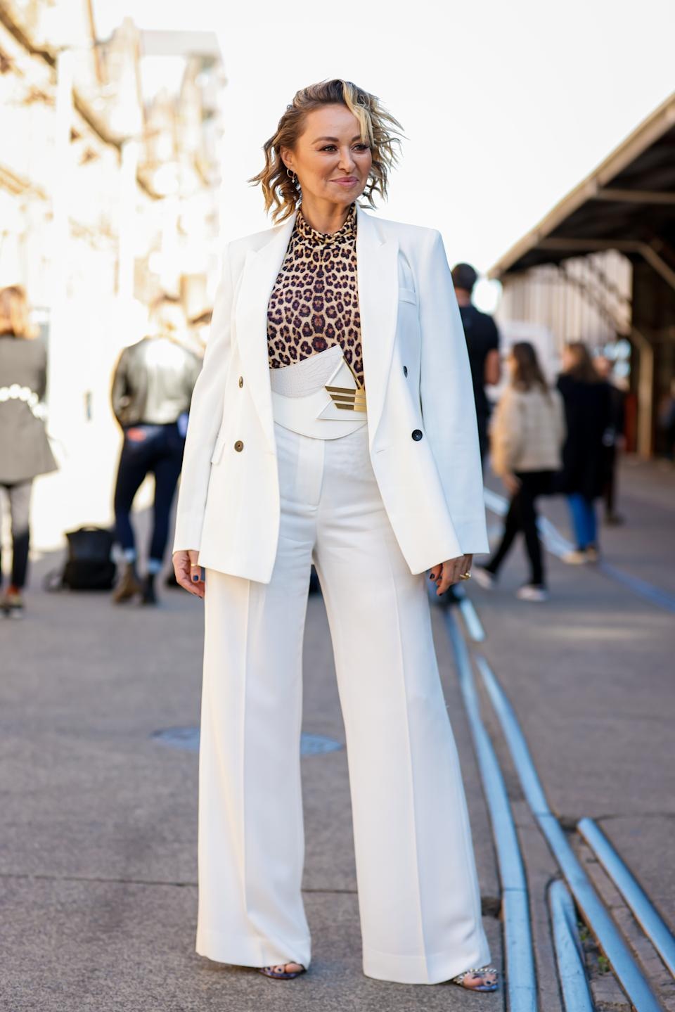 Designer Camilla Franks wearing a white suit, leopard print top and gold belt at Afterpay Australian Fashion Week 2021 on May 31, 2021 in Sydney, Australia.