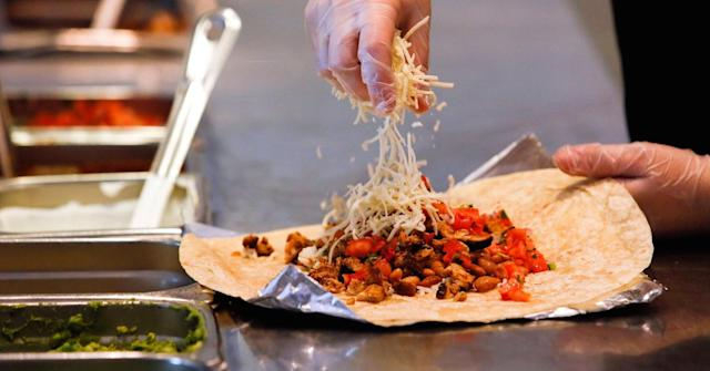 A Chipotle burrito being made. Patrick T. Fallon | Bloomberg | Getty Images.