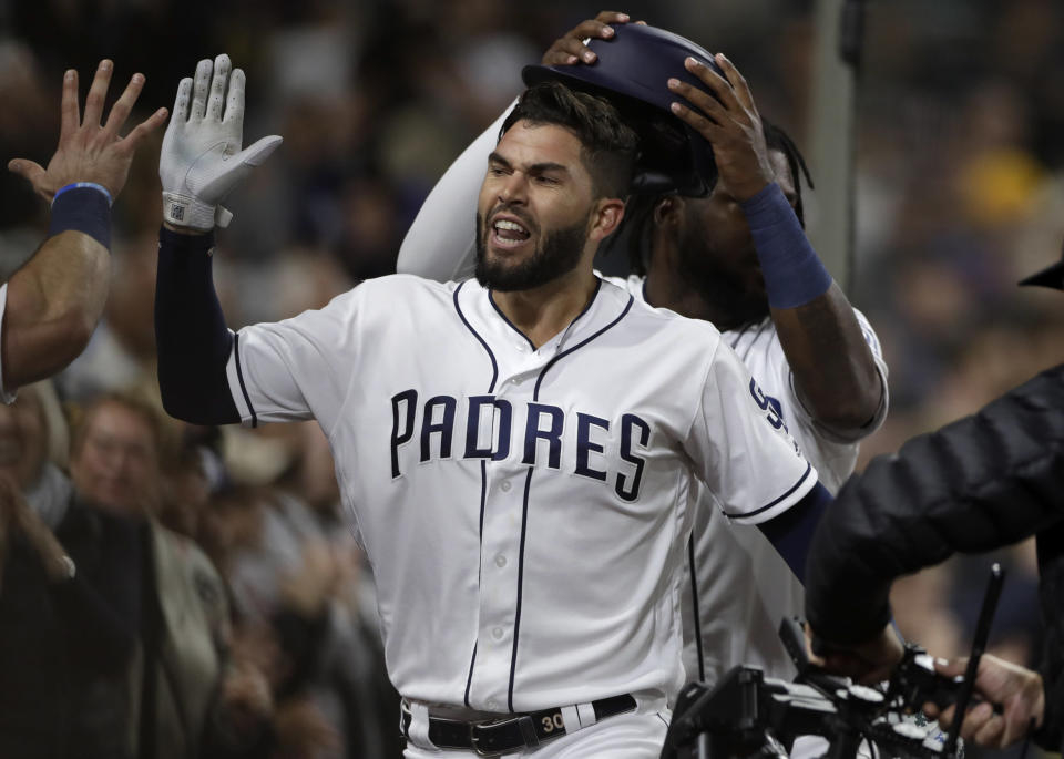 San Diego Padres' Eric Hosmer is congratulated by teammates after hitting a two-run home run during the sixth inning of the team's baseball game against the Arizona Diamondbacks, Tuesday, May 21, 2019, in San Diego. (AP Photo/Gregory Bull)