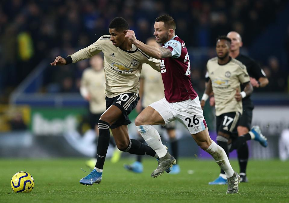 BURNLEY, ENGLAND - DECEMBER 28: Marcus Rashford of Manchester United holds off a challenge by Phil Bardsley of Burnley FC during the Premier League match between Burnley FC and Manchester United at Turf Moor on December 28, 2019 in Burnley, United Kingdom. (Photo by Jan Kruger/Getty Images)