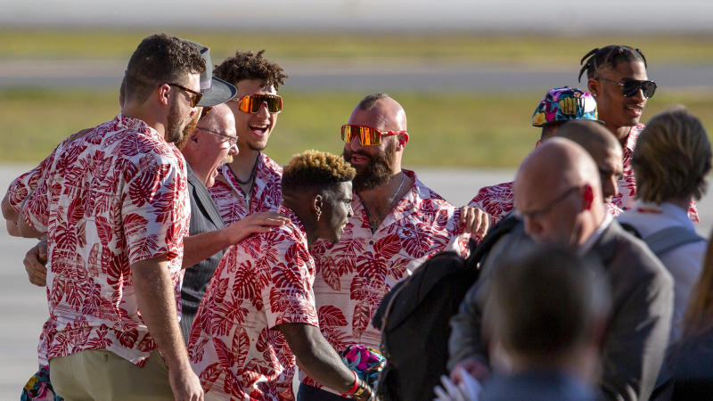 Kansas City Chiefs players pose with coach Andy Reid upon the team's arrival in Miami for Super Bowl LIV. (Daniel A. Varela/Miami Herald/TNS)