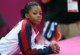 "<div class=""caption-credit""> Photo by: Getty Images</div><div class=""caption-title"">Gabby Douglas and her hair</div>The world cheered when 16-year-old Gabby Douglas won Olympic gold for her gymnastics performance -- the first African-American gymnast ever to do so -- but some people were focused on something other than her fabulous floor routine. On Twitter, people were taking her to task for <a href=""http://shine.yahoo.com/team-mom/defense-gabby-douglas-hair-191700322.html"">not properly straightening her hair</a>. <br> <br> ""That's really sad. Gabby is adorable, extraordinarily talented and people are complaining about how she wears her hair?"" wrote a reader named ""C."" ""It's pulled back out of her face so she can compete, just like ALL the other girls. Some people will never be satisfied with anything."" <br> <br> ""As an African American, sadly I don't find it hard to believe that the focus of Gabby's achievement has taken this turn,"" commented ""Sonny."" ""However, for those of us (African American women) who understand that hair is NOT everything, I salute what an incredible example of accomplishment"