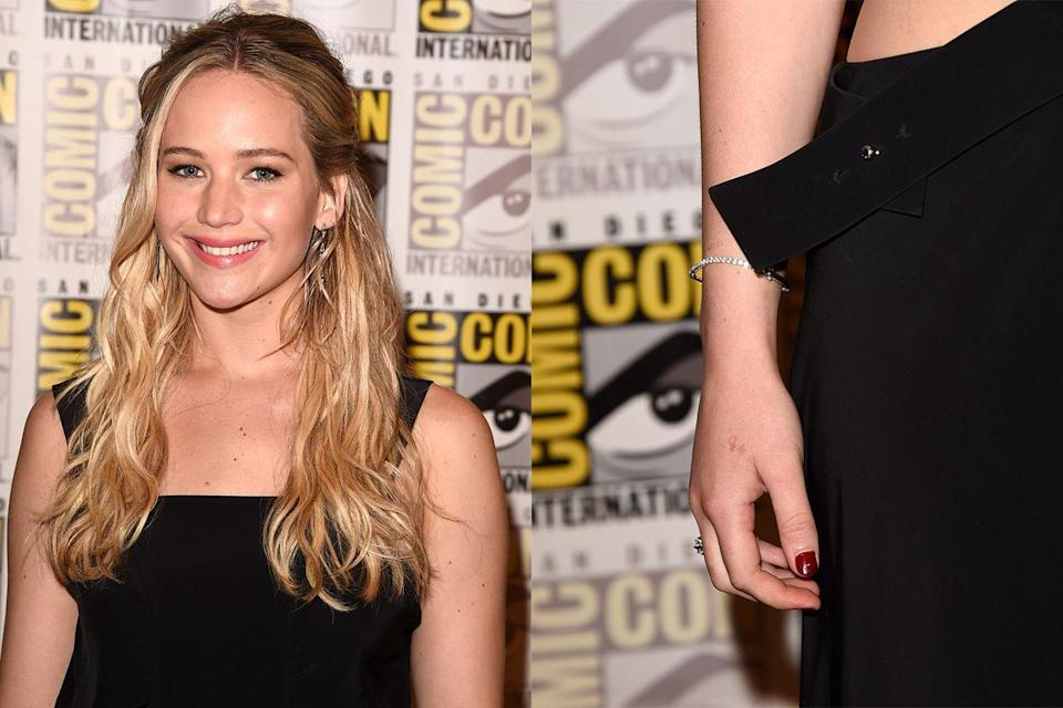 """<p>The <em>Hunger Games </em>actress made a pretty permanent mistake while hanging out with her co-star Liam Hemsworth's family. Since everyone was getting tattoos, she decided to get one, too, choosing to have """"H2O"""" inked in red on her hand...but the number """"2"""" is in the wrong place.</p><p>""""I know the '2' is high, and in H2O, the '2' is supposed to be low,"""" she said in an interview with <em><a href=""""https://www.elle.com/culture/celebrities/news/a29323/jennifer-lawrence-tattoo-mistake/"""" rel=""""nofollow noopener"""" target=""""_blank"""" data-ylk=""""slk:Elle"""" class=""""link rapid-noclick-resp"""">Elle</a></em>. """"I should have googled it before I got it tattooed on my body.""""</p>"""