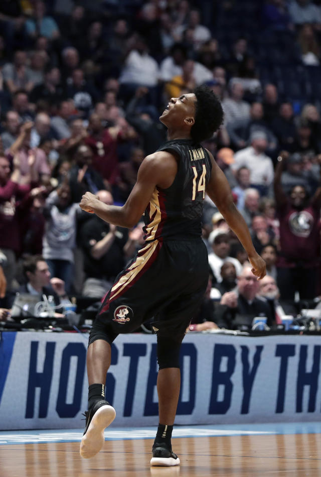 Florida State guard Terance Mann (14) celebrates on the court in the first half of a first-round game against Missouri in the NCAA college basketball tournament in Nashville, Tenn., Friday, March 16, 2018. (AP Photo/Mark Humphrey)