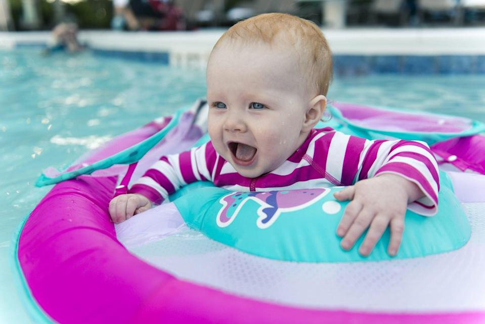 An image of a baby in a pool.