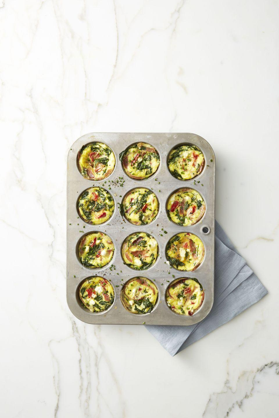 "<p>Get creative with your add-ins for these mini frittatas, but we're partial to this goat cheese-prosciutto combo.</p><p><em><a href=""https://www.goodhousekeeping.com/food-recipes/easy/a42206/spinach-and-prosciutto-frittata-muffins-recipe/"" rel=""nofollow noopener"" target=""_blank"" data-ylk=""slk:Get the recipe for Spinach and Prosciutto Frittata Muffins »"" class=""link rapid-noclick-resp"">Get the recipe for Spinach and Prosciutto Frittata Muffins »</a></em></p>"