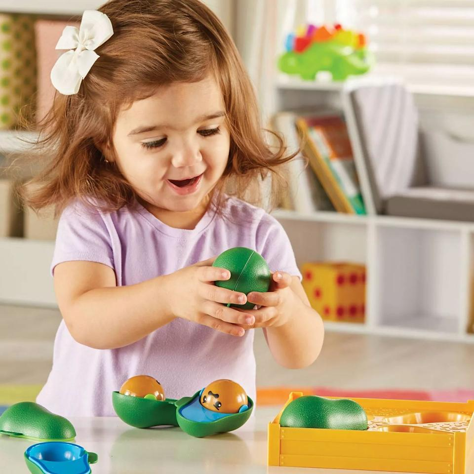 """One's love of guacamole's main ingredient can start at an early age. Plus, this toy really helps with color identification and matching skills.<br /><br /><strong>Get it from Target for<a href=""""https://go.skimresources.com?id=38395X987171&xs=1&url=https%3A%2F%2Fwww.target.com%2Fp%2Flearning-resources-learn-a-lot-avocados-4pc%2F-%2FA-79406186&xcust=HPToddlerToys607dd44ee4b0df3610beec33"""" target=""""_blank"""" rel=""""noopener noreferrer"""">$16.99</a>.</strong>"""