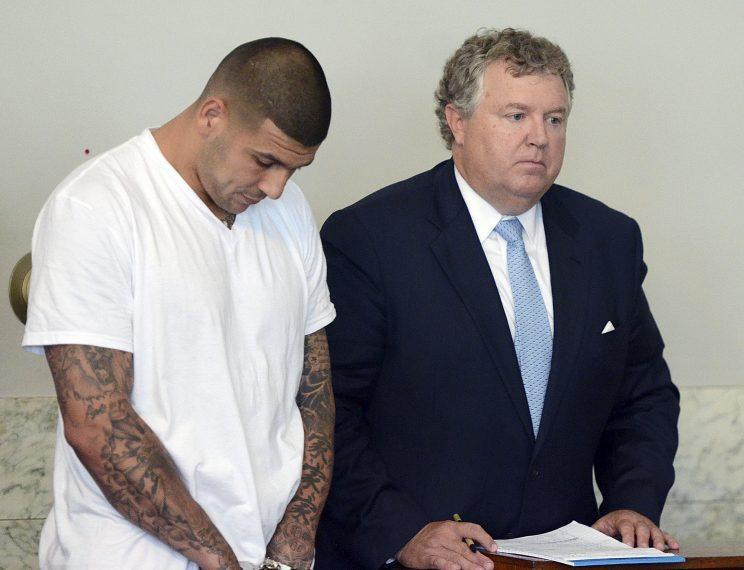 Aaron Hernandez hangs his head during his arraignment for the murder of Odin Lloyd in 2013. (AP)