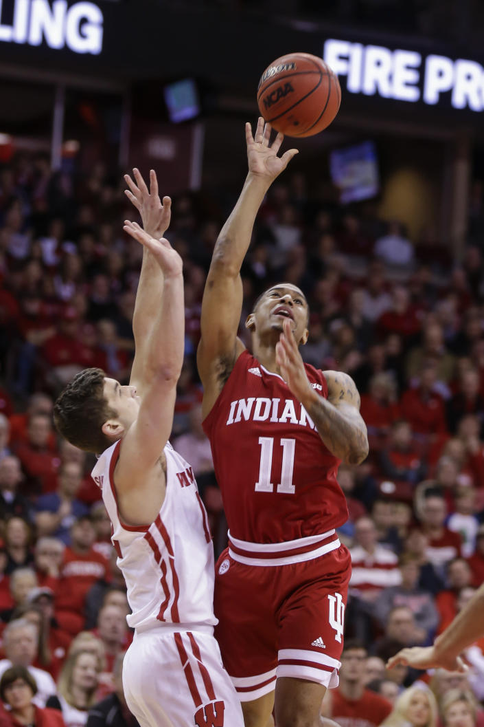Indiana's Devonte Green (11) shoots against Wisconsin's Trevor Anderson during the first half of an NCAA college basketball game Saturday, Dec. 7, 2019, in Madison, Wis. (AP Photo/Andy Manis)