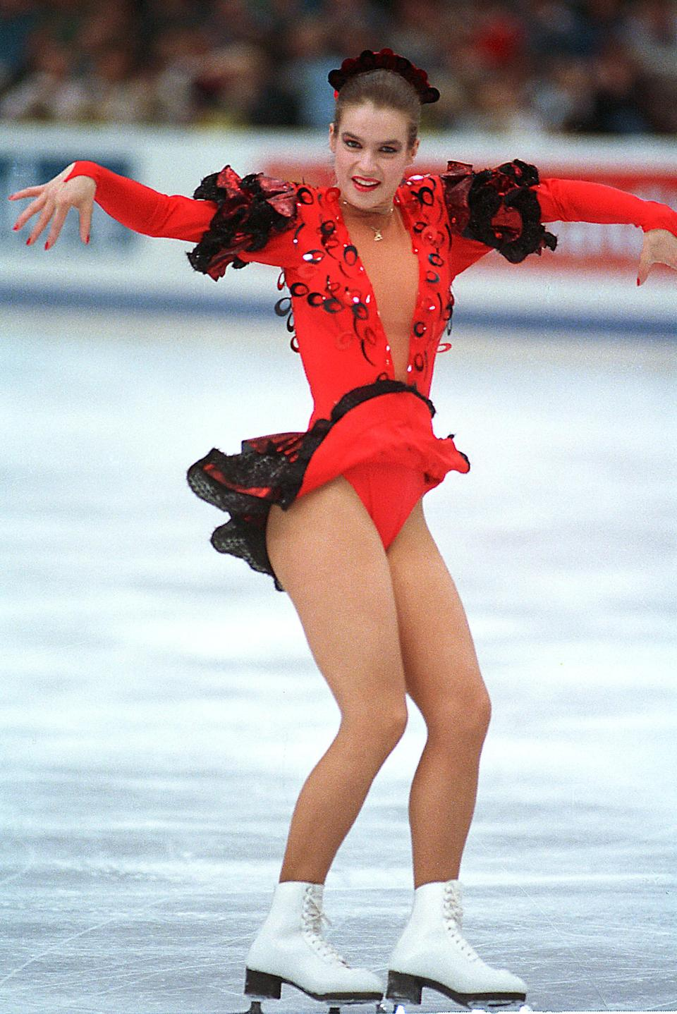 """<p>It was the """"Battle of the Carmens"""" at the Calgary Olympics and that showed in the skating costumes as well. German skater Katerina Witt won the gold medal and did so in a black and red flamenco-inspired dress complete with ruffles and extra frilly sleeves. </p>"""