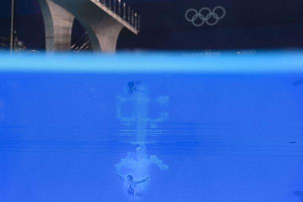 PHOTO: An underwater view shows Mexico's Aranza Vazquez Montano competing in the women's 3m springboard diving semi-final event during the Tokyo 2020 Olympic Games at the Tokyo Aquatics Centre in Tokyo on July 31, 2021. (Francois-xavier Marit/AFP via Getty Images)