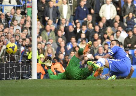 Chelsea's Terry reacts as Everton's Howard scores an own goal during their English Premier League soccer match in London