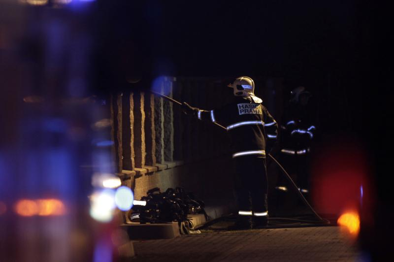 A firefighter works at the site of an explosion in Prague
