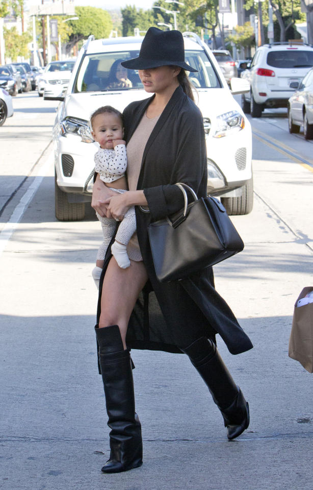 "<p>While out and about with her adorable daughter Luna, the leggy model combined knee-high wedge boots and a long black cardigan with what seems like just an oversized sweater. FYI: she was <a rel=""nofollow"" href=""https://www.yahoo.com/style/chrissy-teigen-basically-goes-pantless-214401043.html"">actually wearing</a> black denim short shorts, but if anyone can pull off the no pants look, it's Chrissy. Work it, girl. <i>(Photo by Splash News)</i></p>"