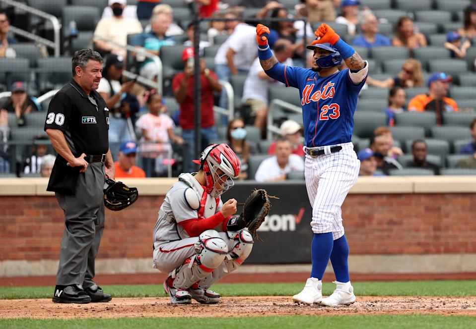 NEW YORK, NEW YORK - AUGUST 29: Javier Baez #23 of the New York Mets reacts after hitting a two run home run during the bottom of the fourth inning of a game against the Washington Nationals at Citi Field on August 29, 2021 in New York City. (Photo by Dustin Satloff/Getty Images)