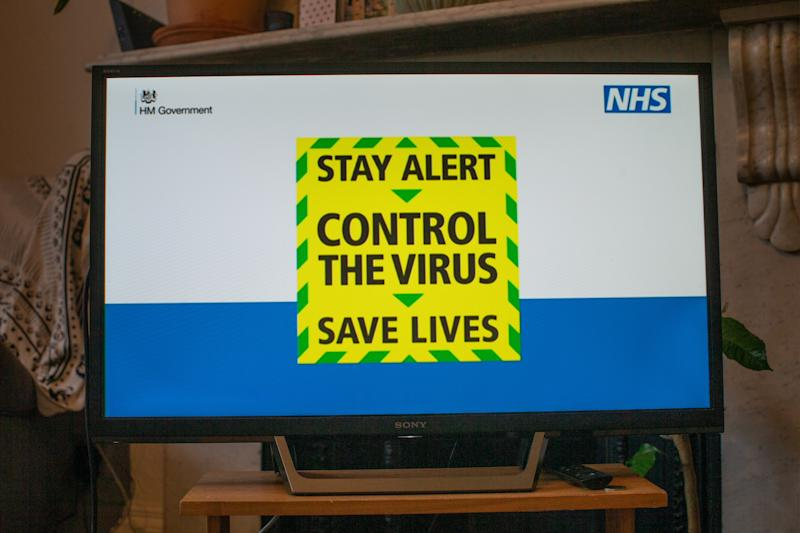 "A message reading ""Stay alert. Control the virus. Save lives"" is screened on a TV in a home in north London during the Prime Minister Boris Johnson message to the nation about coronavirus (COVID-19) from 10 Downing Street, London. Picture date: Sunday May 10, 2020"